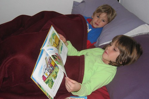Reading The Little Engine That Could to her little brother