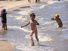 endurance sports(0.0), open water swimming(0.0), skimboarding(0.0), fun(1.0), beach(1.0), sand(1.0), water(1.0), sea(1.0), wave(1.0), vacation(1.0), mud(1.0), coast(1.0),
