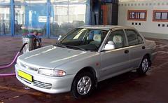 automobile, family car, vehicle, mitsubishi lancer, mitsubishi, compact car, sedan, land vehicle,