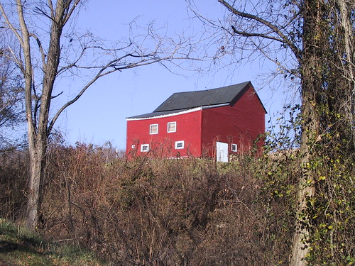 Photograph of a red house in the country