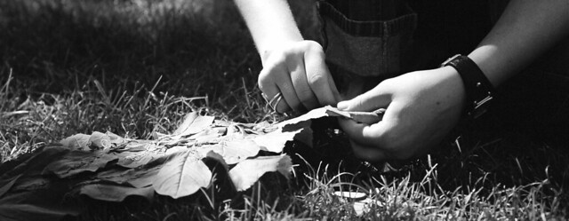 woman sewing leaves