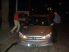 automobile(1.0), automotive exterior(1.0), peugeot(1.0), vehicle(1.0), subcompact car(1.0), peugeot 206(1.0), compact car(1.0), bumper(1.0),