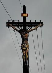 art, symbol, sculpture, line, electricity, crucifix, cross, lighting, statue,