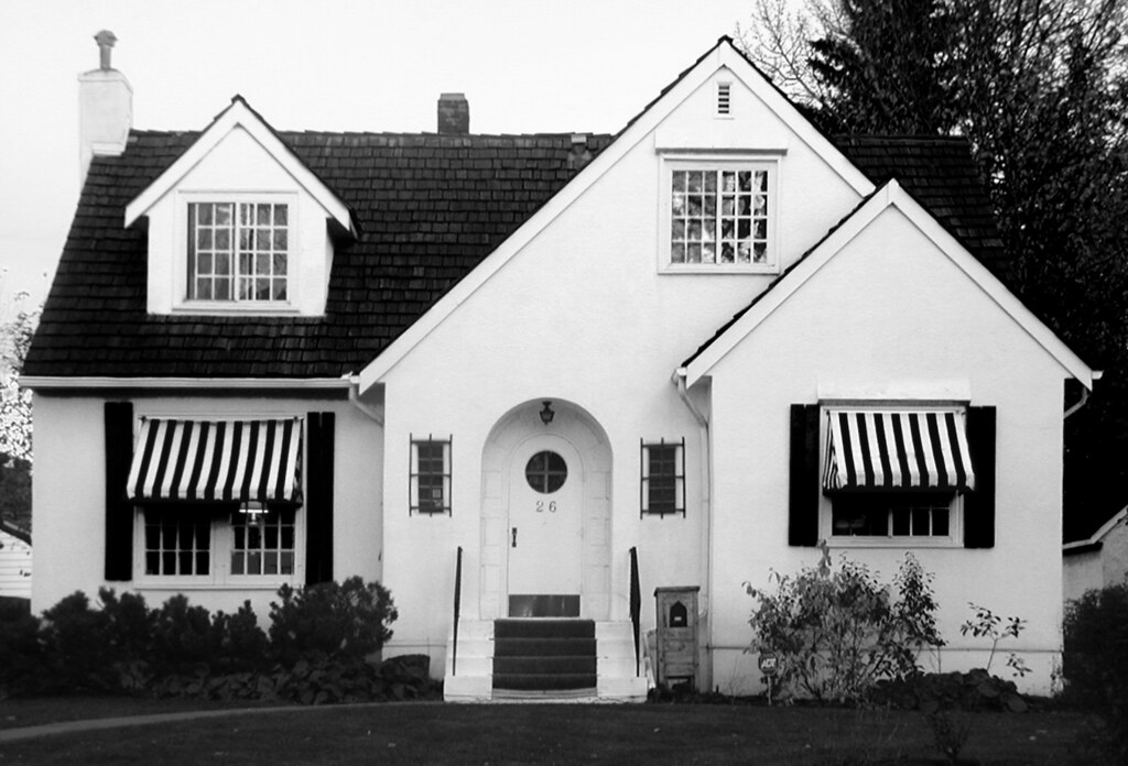 house with striped awnings