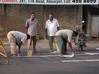 How many people does it take to paint a line?