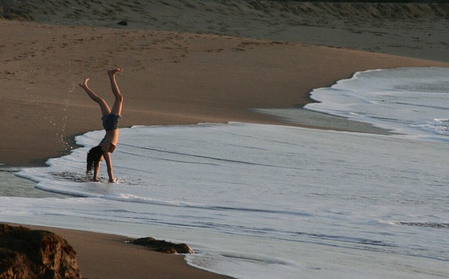 cartwheels in the surf