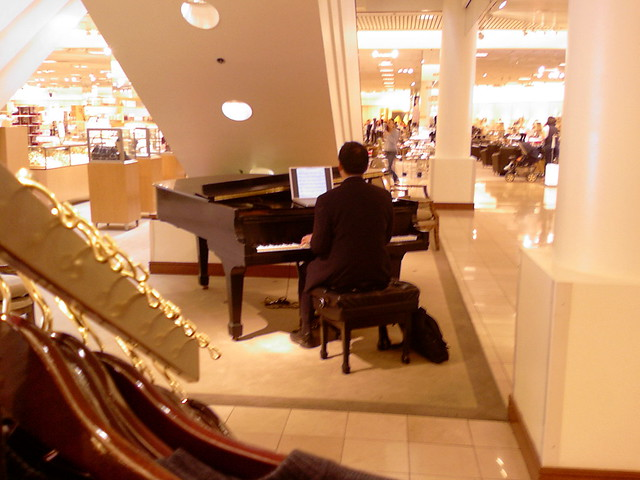 nordstrom piano guy reading music from laptop
