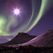 Aurora borealis dancing with the moon by Gunnlaugur