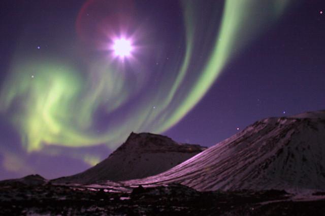 Aurora borealis dancing with the moon