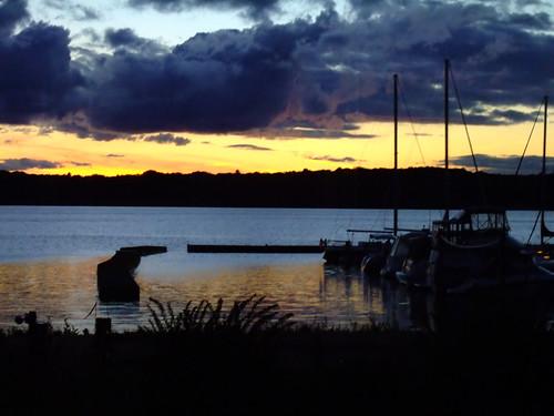 sunset reflection water clouds bay dock michigan f10 lakemichigan greatlakes traversecity joeldinda grandtraverse bowersharbor