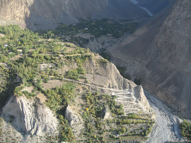 Village at the foot of Buni Zom, with jeep track down to the Mastuj river