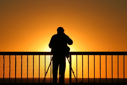 Photographer getting a sunset picture