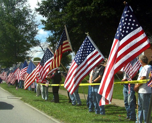 Flag Waving along funeral motorcade