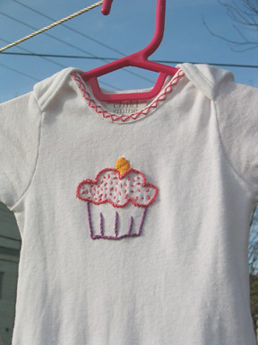 Cora's embroidered onesie