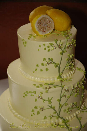Pale yellow buttercream icing with spring green tree branches and foliage
