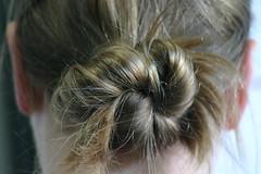 layered hair(0.0), french braid(0.0), hair coloring(0.0), forehead(0.0), braid(0.0), hairstyle(1.0), chignon(1.0), bun(1.0), hair(1.0), brown hair(1.0), blond(1.0),