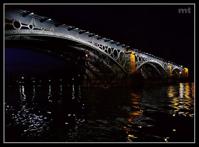 Cuando paso por el puente, Triana...