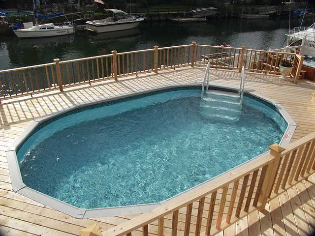 Above ground vinyl pool cedar deck flickr photo sharing for Above ground pool vinyl decks