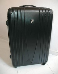 musical instrument(0.0), bag(1.0), hand luggage(1.0), baggage(1.0), suitcase(1.0),