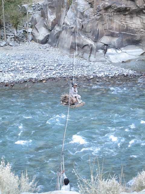 Man crossing the Gilgit river by traditional means....