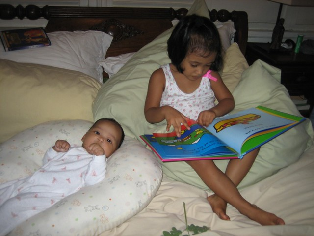 Soph reads to Lily