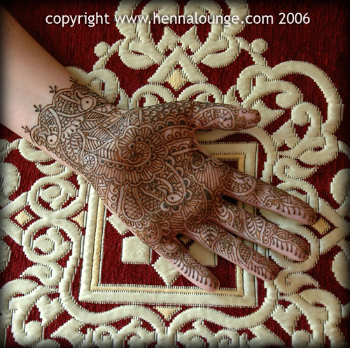 Intricate mehndi pattern height=496