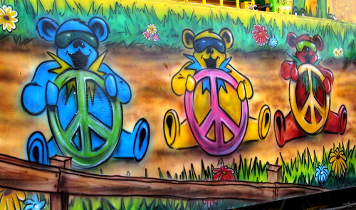 Three bears steering peace signs.