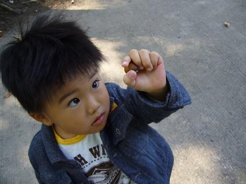 child w/ an acorn