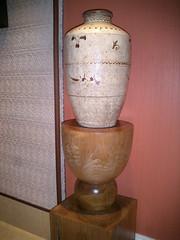 carving(0.0), sculpture(0.0), lighting(0.0), art(1.0), wood(1.0), pottery(1.0), urn(1.0), vase(1.0), ceramic(1.0),