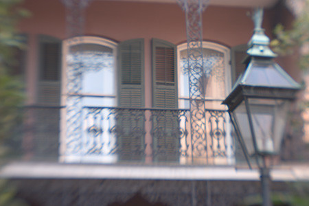 Street lamp and balcony detail, French Quarter, New Orleans, Louisana.