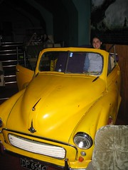 taxi(0.0), mid-size car(0.0), sedan(0.0), automobile(1.0), automotive exterior(1.0), yellow(1.0), vehicle(1.0), hindustan ambassador(1.0), compact car(1.0), antique car(1.0), classic car(1.0), vintage car(1.0), land vehicle(1.0), motor vehicle(1.0), classic(1.0),