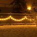 Garden lights in the snow 1 by istargazer