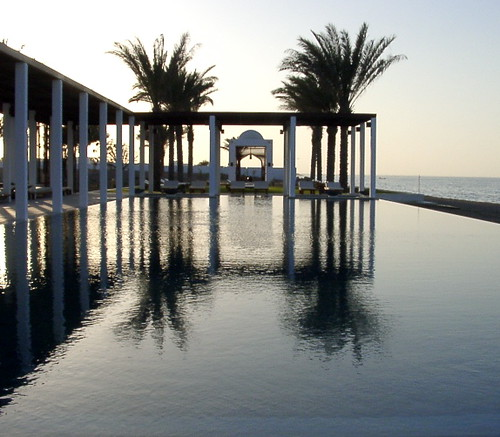 sunset sea beach water pool architecture reflections geotagged hotel mirror middleeast palmtrees oman muscat thechedi arabianpeninsula cruisair geo:lat=23603564 geo:lon=58398063