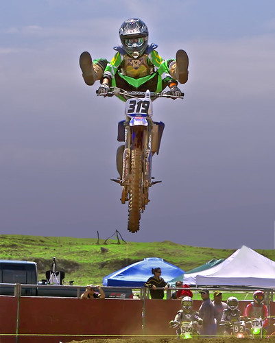 boy hawaii hotdog jump uniform helmet explore motorcycle waimea kane airborne kamuela parkerranch keikimotocross