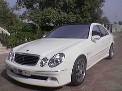automobile(1.0), automotive exterior(1.0), wheel(1.0), vehicle(1.0), rim(1.0), mercedes-benz clk-class(1.0), bumper(1.0), mercedes-benz e-class(1.0), sedan(1.0), land vehicle(1.0), luxury vehicle(1.0),