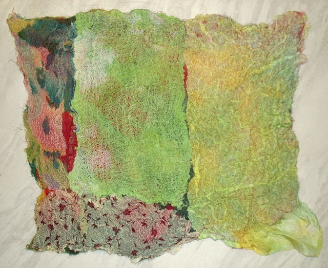 A sample of felt with additional fabrics