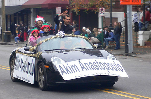 Local celebrity Akim Anastopoulo rides in the 26th Annual Charleston Christmas Parade