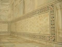 arch(0.0), wood(0.0), molding(0.0), ceiling(0.0), estate(0.0), wood flooring(0.0), wallpaper(0.0), floor(1.0), carving(1.0), wall(1.0), interior design(1.0), relief(1.0), design(1.0), tile(1.0), plaster(1.0), flooring(1.0),