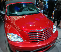 minivan(0.0), automobile(1.0), automotive exterior(1.0), wheel(1.0), vehicle(1.0), automotive design(1.0), chrysler pt cruiser(1.0), auto show(1.0), compact car(1.0), chrysler(1.0), bumper(1.0), land vehicle(1.0), luxury vehicle(1.0), motor vehicle(1.0),