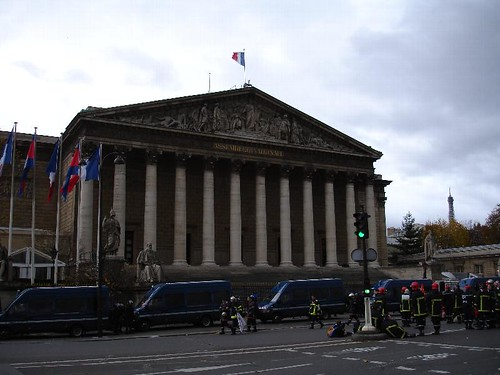 French Assemblée nationale with firemen marching and cops