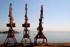 petroleum(0.0), drilling rig(0.0), jackup rig(0.0), mast(0.0), offshore drilling(0.0), construction equipment(0.0), vehicle(1.0), oil field(1.0),