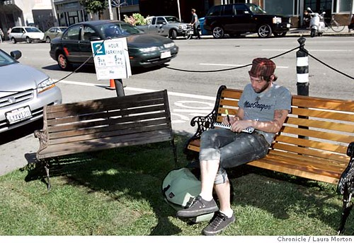 Daniel Pelt enjoys Rebar's momentary park on Howard Street.