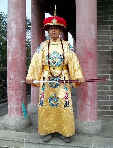 A guy disguised as a Chinese emperor