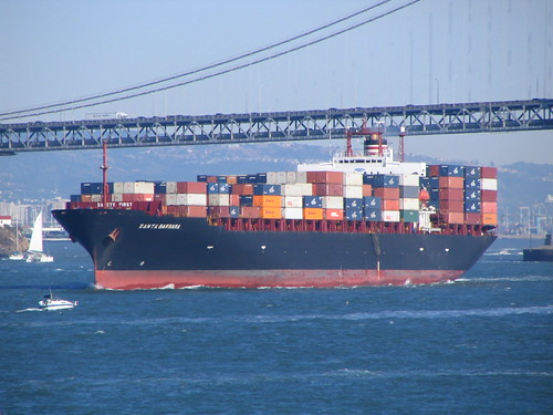 container ship leaving bay area