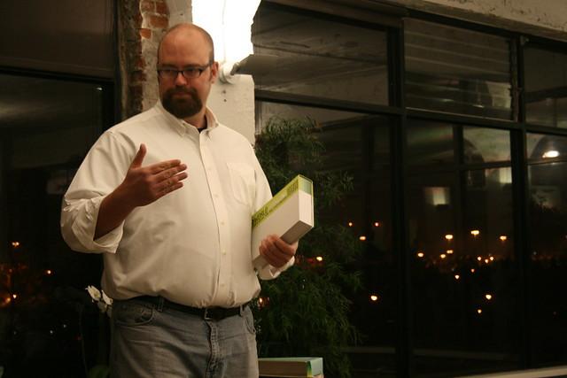 Alex Steffen Holding the WorldChanging Book at Workspace