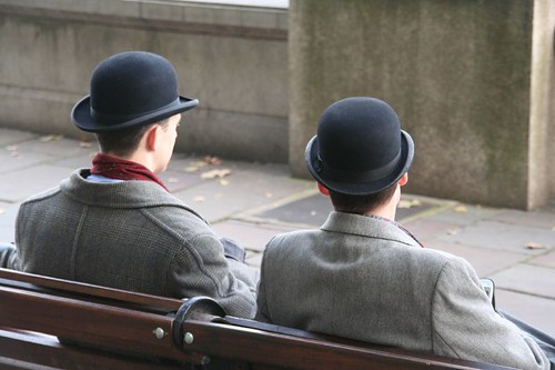 Two bowler hats on the Thames