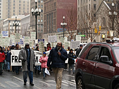 Abayomi Azikiwe, editor of the Pan-African News Wire, holding microphone at Detroit MLK Day March on Washington Blvd. downtown, January 15, 2007. (Photo: Robert Akrawi). by Pan-African News Wire File Photos