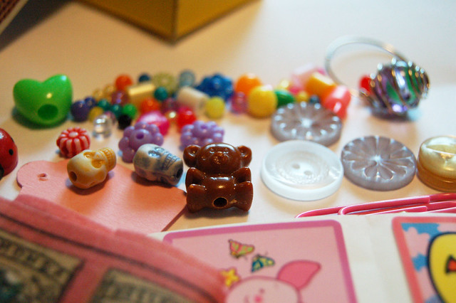 Tiny beads, buttons and ribbons inside a matchbox
