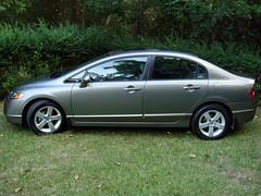 automobile(1.0), automotive exterior(1.0), family car(1.0), wheel(1.0), vehicle(1.0), rim(1.0), compact car(1.0), bumper(1.0), honda civic hybrid(1.0), sedan(1.0), land vehicle(1.0),