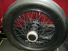 automobile(0.0), steering wheel(0.0), formula one tyres(0.0), alloy wheel(0.0), bumper(0.0), bicycle wheel(0.0), tire(1.0), automotive tire(1.0), automotive exterior(1.0), wheel(1.0), vehicle(1.0), rim(1.0), spoke(1.0),